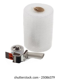 Large roll of bubble wrap and tape dispenser isolated on white