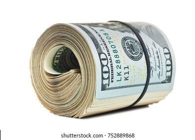 A large roll of hundred dollar bills knitted by a black rubber band isolated on white background