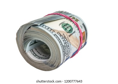 A large roll of one hundred dollar bills on a white background. Isolated.