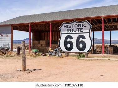 Large Route 66 sign next to the road in Arizona, USA