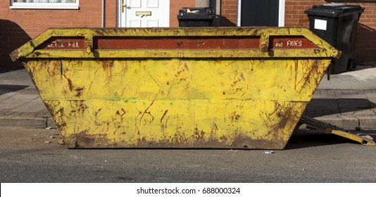 Large rusted yellow skip/dumpster