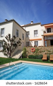 Large rustic hotel and swimming pool set in beautiful gardens in the Spanish countryside
