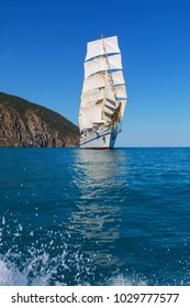Large sailboat against the blue sky on a sunny day