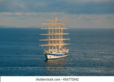 Large sailing ship enters the bay near Sorrento. Italy.