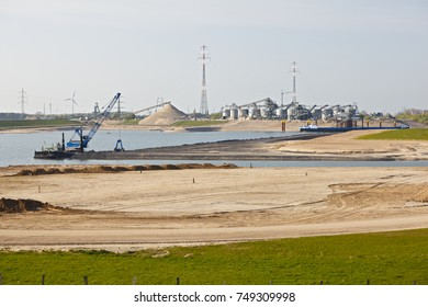A large sand and gravel plant area destroying the Rhine river landscape near Duisburg, Germany.