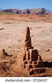 Large sandcastle with southern utah landscape in background.