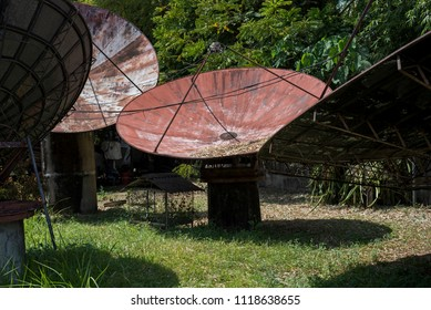 Large old radio images stock photos vectors shutterstock large satellite dishes abandoned in a garden in the philippines malvernweather Images