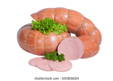 Large sausage in synthetic shell isolated on white background. Whole and partially sliced product. Decorated with leaf of lettuce and branch of parsley
