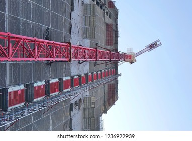 Large scale construction site with crane seen in perspective