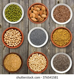 Large seed super food selection in bowls on a wooden background
