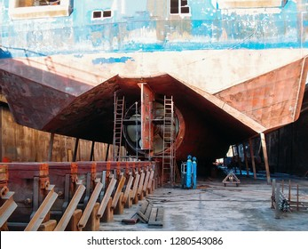 Large seismic or cargo ship in dock on harbor for repair and maintenance, Industrial nautical vessel boat in dockyard, close up