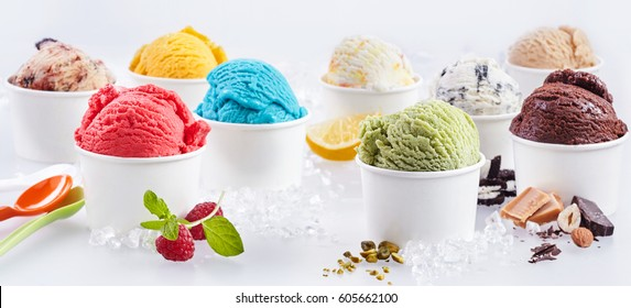 Large selection of artisanal takeaway ice cream in tubs each with the fresh ingredients alongside including raspberry, pistachio, bubblegum, caramel, chocolate, hazelnut and lemon