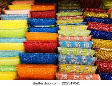 Large selection of sponges for washing dishes and surfaces. Multi-colored washcloths on the store shelf, how to choose, sale.