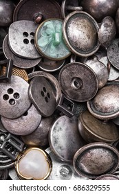 Large set of stylish old-fashioned metal buttons for clothes
