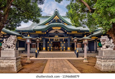 Large Shinto Shrine with Two Stone Guardian Komainu Statues and Lanterns along Entrance Pathway (Tokyo, Japan).