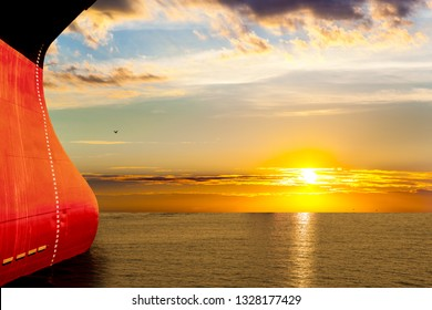 Large Ship bow on sea in the rays of the setting sun.