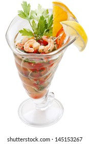 Large shrimp cocktail with lemon, pepper and onion isolated on white background
