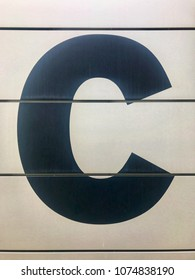 Large sign with the letter C on the entrance of a building