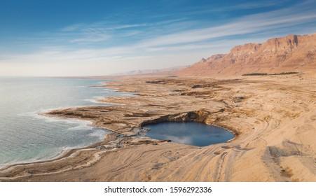 A large sinkhole along the Dead Sea shore line near Ein Gedi in southern Israel.