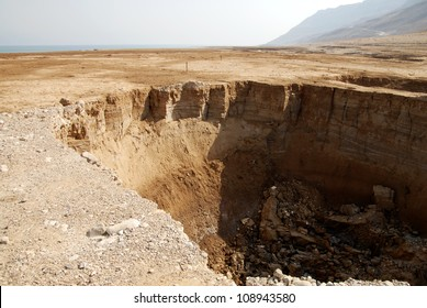 Large sinkhole in the Dead Sea, Israel. Formed when underground salt is dissolved by freshwater intrusion, due to continuing sea-level drop.