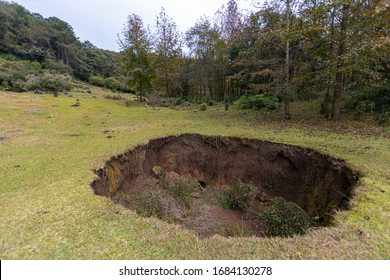 Large sinkhole in a valley in the middle of the mountains in el Cielo, Tamaulipas, Mexico