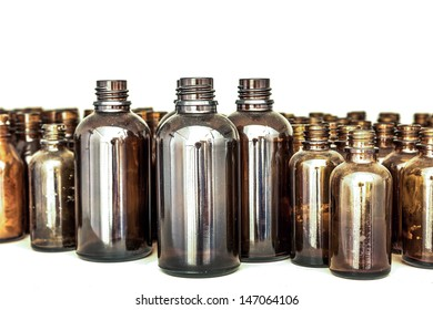 large and small brown medical glass