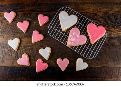 Large and Small Heart Shaped Cookies with Pink and White Icing
