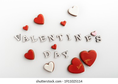 Large and small hearts on white background next to the inscription Valentines day
