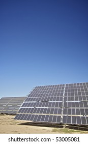 large solar panels with clear blue sky