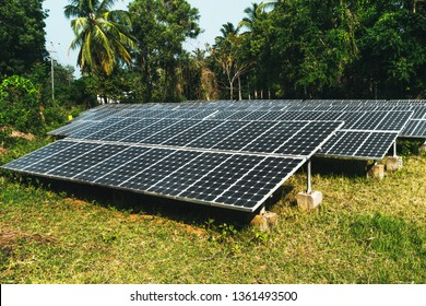 Large solar panels in the rainforest. Alternative solar energy. Electrification of the Andaman Islands. photovoltaic battery in the forest among the palm trees
