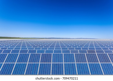 large solar power plants with blue sky, new energy background