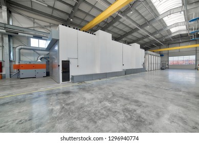 Large, spacious and light factory workshop. Large spray booth inside the workshop.