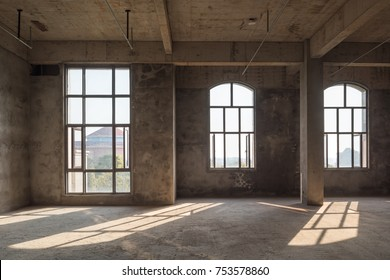 large spacious room, illuminated by natural light from windows,Empty interior space,