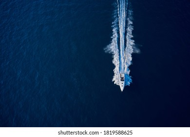 Large speed boat moving at high speed. Top view of a white boat sailing to the blue sea. Drone view of a boat sailing. Motor boat in the sea. Travel - image. - Shutterstock ID 1819588625