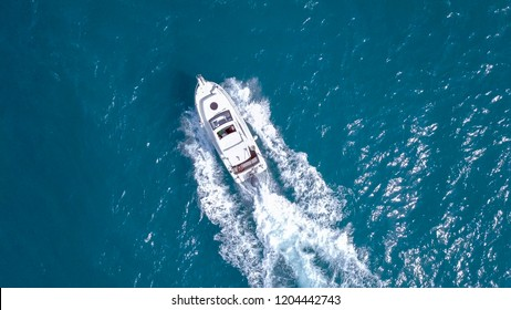 Large speedboat roaring across the Mediterranean Sea - Top down aerial image.