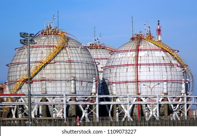 Large spherical fuel storage tanks with fuel pipes and ladders