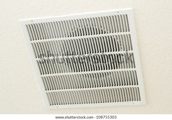 Large square white return air vent located in the ceiling of a home.