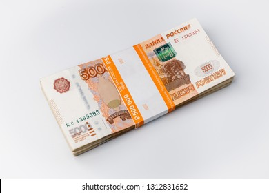 Large stack of banknotes, Russian rubles isolated on white background, packed stack of banknotes 5000 rubles, five hundred thousand