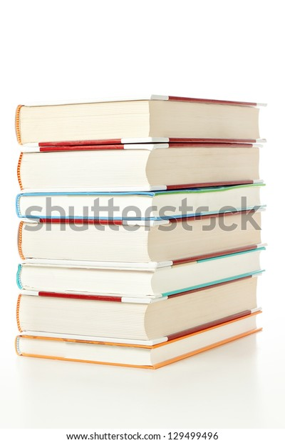 Large stack of books from the library, on a white background.