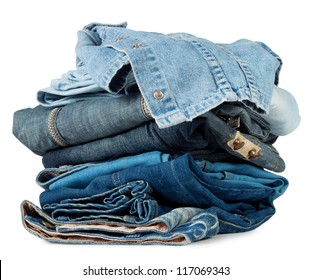 A large stack of colored denim products isolated on white background