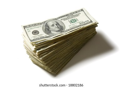 Large stack of hundred dollar bills isolated on a white background