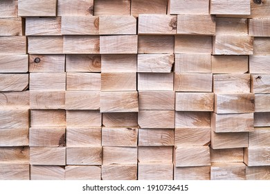 Large stack of new boards of natural solid birch for table legs production in contemporary carpentry warehouse close view