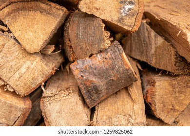 large stacks of firewood. ready to make a fire at a fireplace giving warmth.