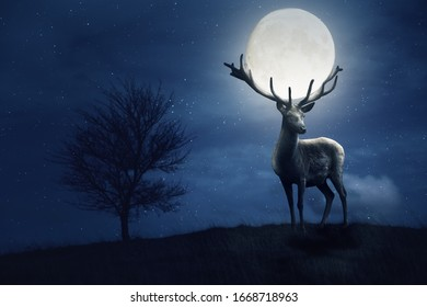 A large stag with a magnificent set of Antlers stands on a hill in a full moon night