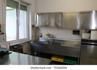 large stainless steel bucket in an industrial kitchen for prepar