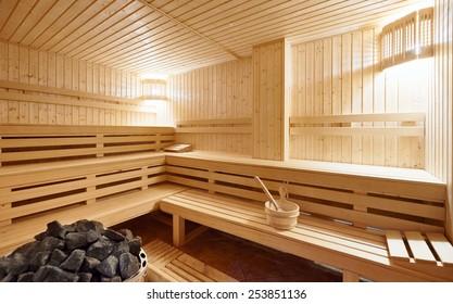 Large standard-design Finland-style classic wooden sauna interior in public building, hotel