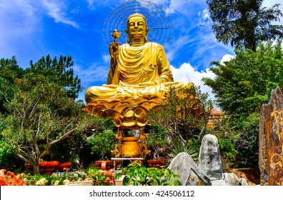 A large statue of golden Buddha. Dalat Vietnam
