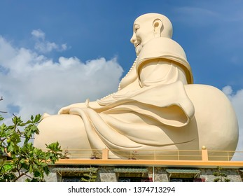 Large statue of sitting Buddha at Vinh Trang Pagoda in My Tho, Vietnam.