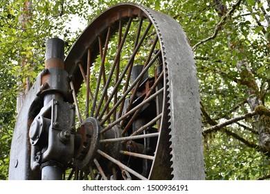 Large steam powered logging bandsaw.