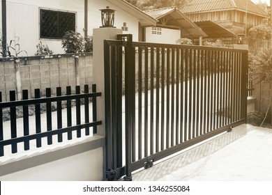 Large steel fence door at the front of the house